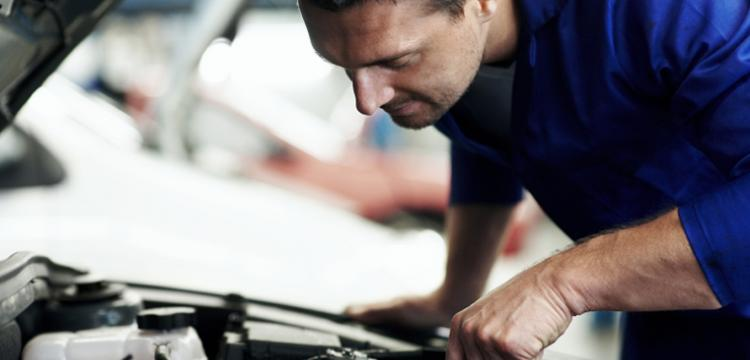Man looking under bonnet