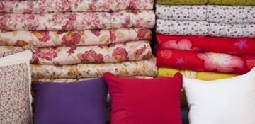 Colourful cushions and bedding