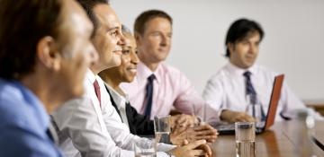 Group of people smiling in a meeting