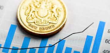 Graphic showing a pound coin on top of a. growth chart